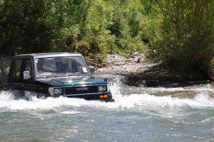 Suzuki deep in a river in New Zealand