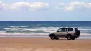 Toyota Land Cruiser driving on the beach